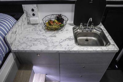 Internal stainless glass top sink